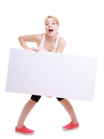 Fit fitness woman funny wide eyed holding sign  Sporty girl with blank billboard banner   Isolated on white background  photo