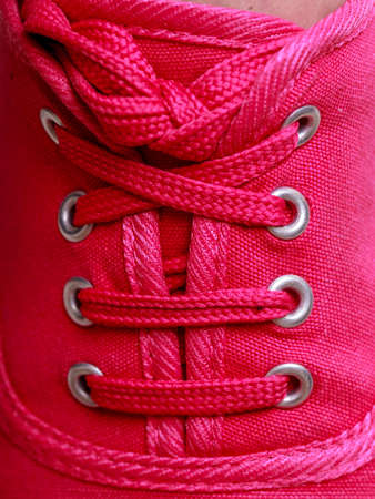 plimsoll: Closeup of casual vibrant pink sneakers plimsolls shoes boots on female feet  Sport fashion