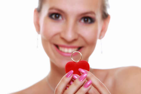 diamond shaped: Girl happy bride in white dress showing engagement or wedding ring in red heart shaped box isolated on white background.