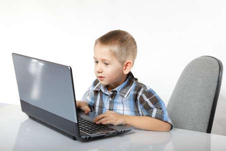 Computer addiction child boy with laptop notebook white background photo