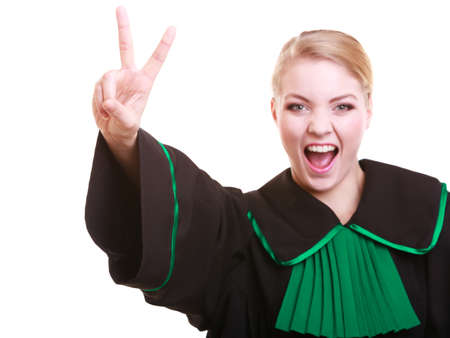Law court or justice concept. Young woman lawyer attorney wearing classic polish (Poland) black green gown making ok sign victory hand gesture isolated on white background photo