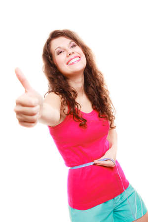 losing control: Weight loss young sport fitness woman with measure tape. Happy girl showing thumb up success hand sign isolated. Diet and nutrition. Studio shot. Stock Photo