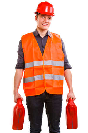 Young man construction worker in orange safety vest and red hard hat holding plastic canisters isolated on white photo