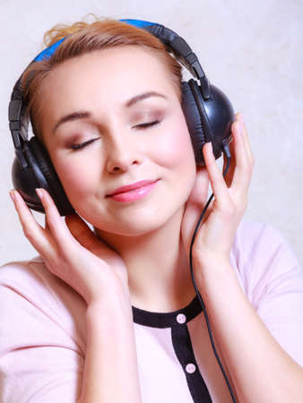 Portrait of modern businesswoman young woman or student girl with headphones photo