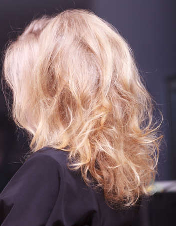 Female blond wavy hair photo