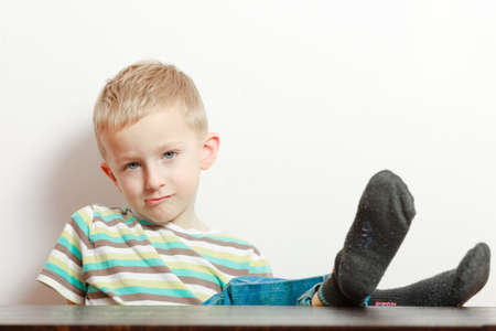Portrait of bored naughty boy child preschooler making sulky moody face