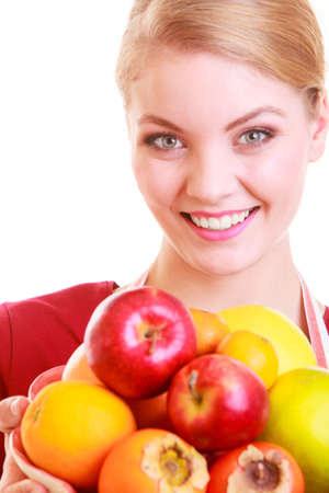 Happy housewife or seller offering healthy fruits isolated studio shot. Diet and nutrition. photo
