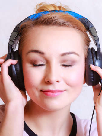 Portrait of modern businesswoman young woman or student girl with headphones listening to music mp3 relaxing or learning language. photo
