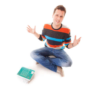 reluctance: Exhausted tired college student with pile of books studying for exams isolated on white background