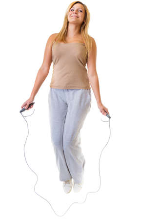 Sport girl plus size doing exercise with skip jump rope - weight loss  Fitness young woman isolated  Studio shot  photo