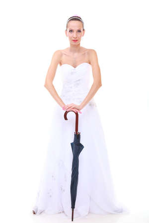 Wedding day at a raining day  Full length romantic bride with blue closed umbrella isolated on white background photo