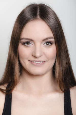 sportwear: Beautiful long hair girl in sportwear young woman portrait on gray background.