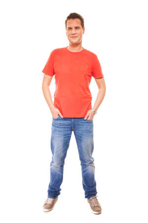 casual fashion: Full length young man wearing red t-shirt jeans casual fashion style with hands in pockets, isolated on white background