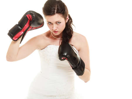emancipation: Emancipation. Bride in wedding dress wearing boxing gloves. Woman showing her power domination isolated. Stock Photo