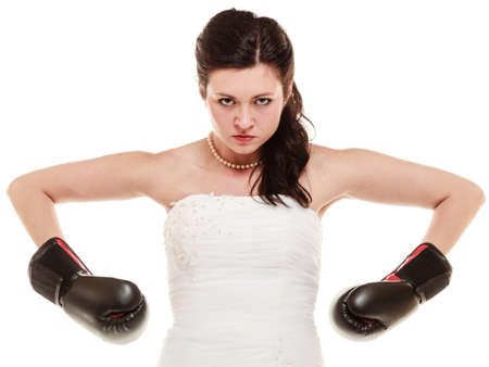 emancipation: Emancipation  Bride in wedding dress wearing boxing gloves  Woman showing her power domination isolated