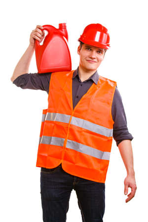 Young man construction worker in orange safety vest and red hard hat holding plastic canisters isolated on white  Industrial power and energy  Studio shot  photo