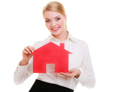 Woman real estate agent holding red paper house  Property, business and accomodation concept  isolated on white background Stock Photo