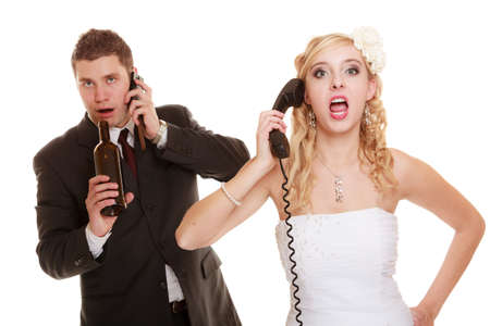 Angry woman and drunk man talking on the phone. Couple bride and groom quarreling  photo