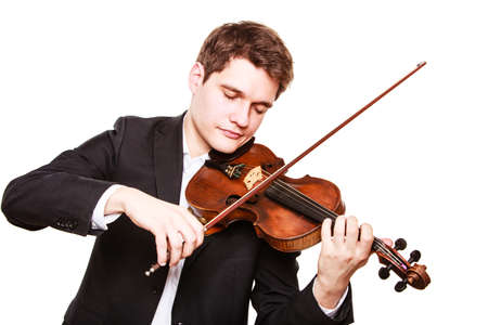 Art and artist  Young elegant man violinist fiddler playing violin isolated on white  Classical music  Studio shot