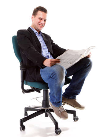 Full length businessman sitting on chair reading a newspaper isolated on white background photo