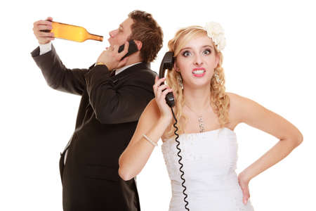 argues: Wedding relationship difficulties. Angry woman and drunk man talking on the phone. Couple bride and groom quarelling isolated on white. Addiction and alcoholism.