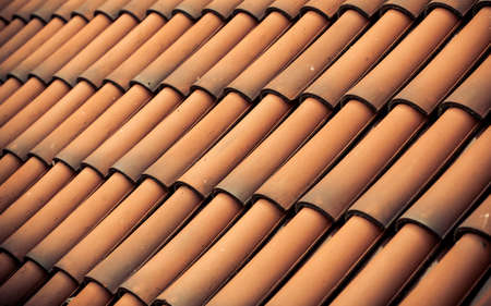 Red tiles roof texture architecture background, detail of house close up photo
