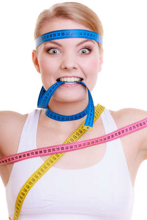 obsessed: Time for diet slimming weight loss concept  Health care healthy lifestyle  Sport fit fitness woman with a lot of colorful measure tapes around her head  Obsessed girl by your body   isolated on white background