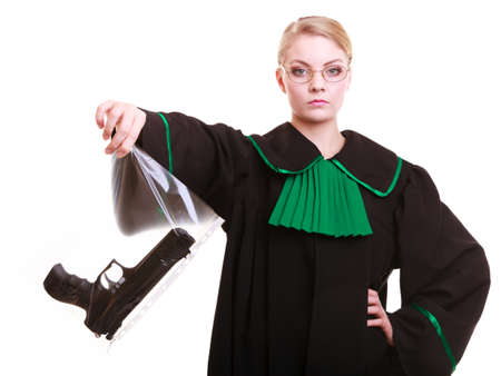 evidence bag: Law court or justice concept  Woman lawyer attorney wearing classic polish  Poland  black green gown with weapon gun - bag marked evidence for crime  isolated on white background
