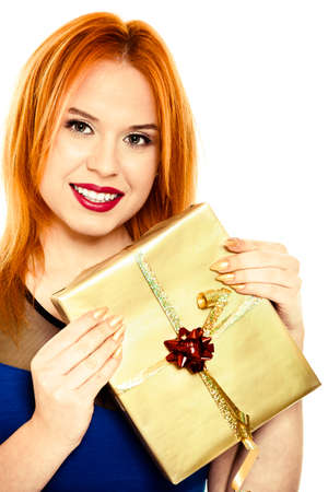 red haired woman: Young happy red haired woman with a gift box present  People celebrating holidays concept  Studio shot isolated on white background