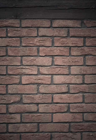 Architecture. Closeup of red brick wall with wooden beam as texture or background. Architectural detail. photo