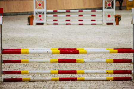 equitation: Equitation  Yellow red white obstacle for jumping horses  Riding competition  Real