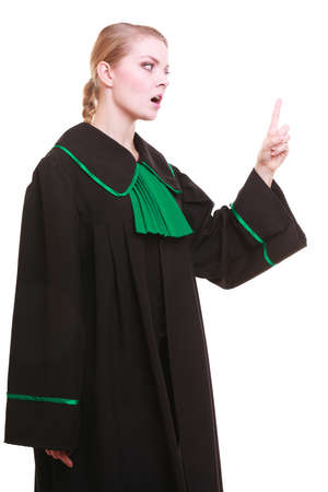 Law court or justice concept. Woman female person lawyer attorney wearing classic polish (Poland) black green gown, wagging her finger girl scolding isolated on white background photo