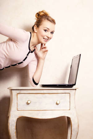Technology internet modern lifestyle. Young businesswoman woman student girl working on computer laptop at the retro desk. Business at home. photo