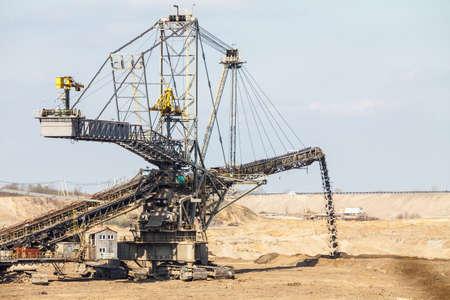 Open pit. Opencast brown coal mine. Giant excavator machinery. Extractive industry. photo