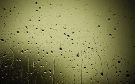 Closeup of water drops droplets raindrops on glass window as background texture. Rain. Stock Photo