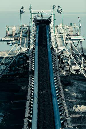 Opencast brown coal mine. Belt conveyor as industrial detail.