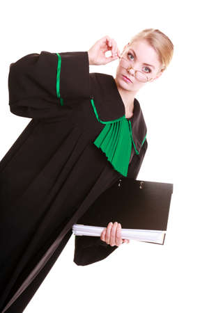 judicature: Law court or justice concept  Young woman lawyer attorney wearing classic polish  Poland  black green gown with file folder or dossier isolated  Stock Photo