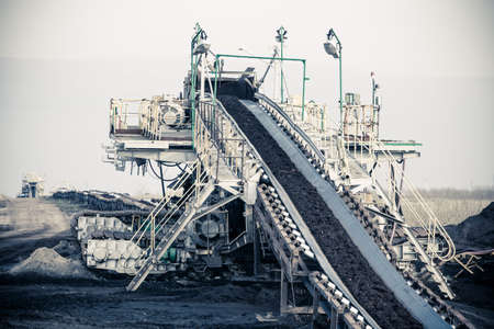 Open pit. Opencast brown coal mine. Belt conveyor as industrial detail.