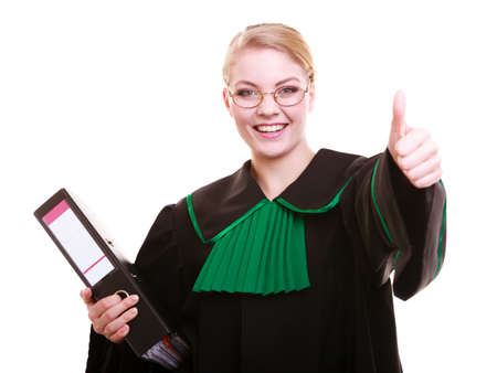 judicature: Law court or justice concept  Young woman lawyer attorney wearing classic polish  Poland  black green gown with file folder or dossier thumb up hand gesture isolated on white background