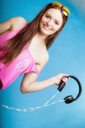 Fashion teen girl headphones listen music mp3 player photo