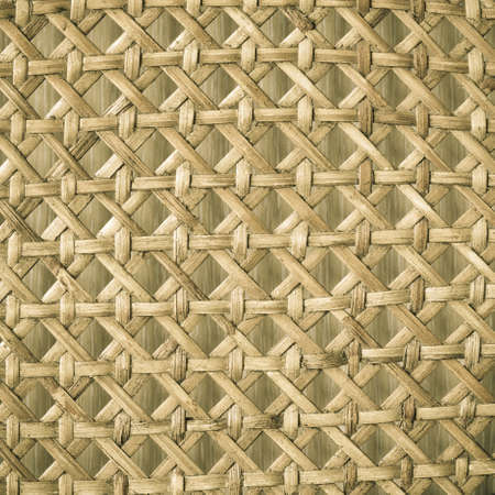 Closeup of beige basket. Wicker woven pattern for abstract background or texture. Square format.