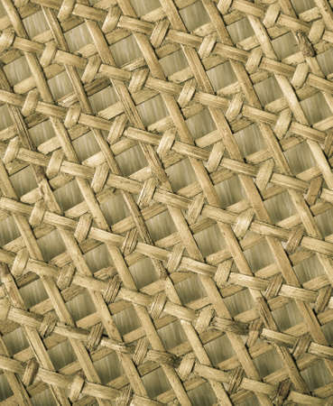 Closeup of beige basket. Wicker woven pattern for abstract background or texture photo