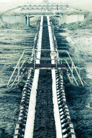 Open pit. Opencast brown coal mine. Belt conveyor as industrial detail. photo