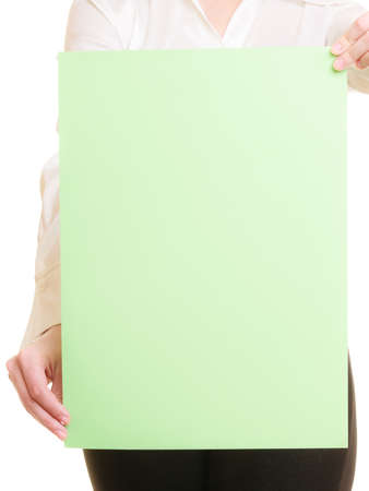 recommending: Advertisement. Blank copy space green banner in hands of woman. Businesswoman recommending your product