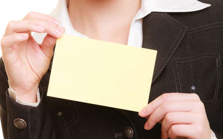 Advertisement. Blank copy space yellow business card in hands of woman. Businesswoman recommending your product photo