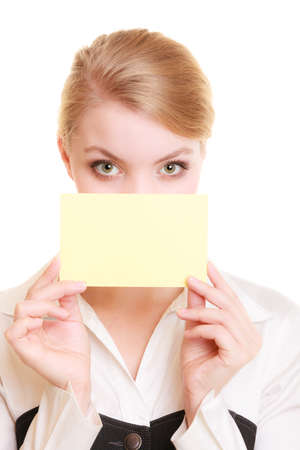 recommending: Advertisement. Young woman covering face with blank copy space yellow business card isolated on white. Businesswoman recommending product
