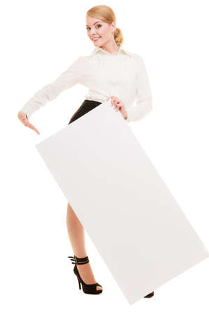 Advertisement. Elegant young woman holding blank copy space banner isolated on white. Businesswoman recommending your product. photo