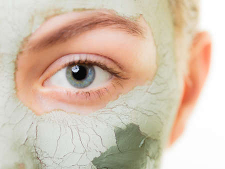 dry skin: Skin care  Woman in clay mud mask on face isolated on white  Girl taking care of dry complexion  Beauty treatment