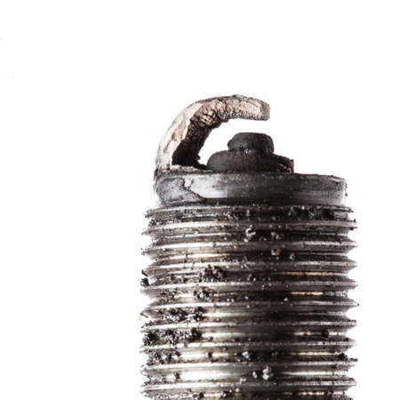 Auto service  Old rusty spark plug as spare part of car transportation isolated on white  photo