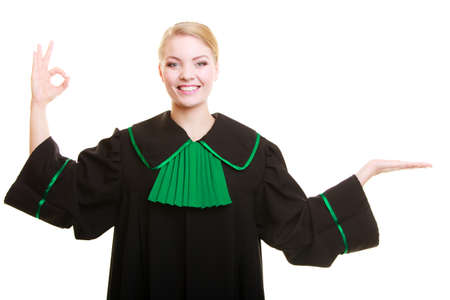agreeing: Law court or justice. Woman lawyer attorney wearing classic polish (Poland) black green gown showing ok okay success hand sign gesture and blank copy space on empty palm isolated.
